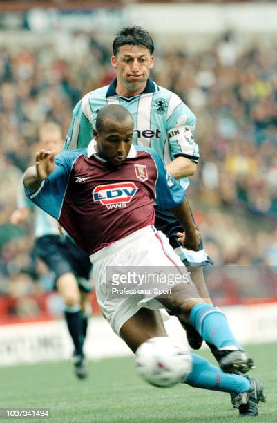 Julian Joachim of Aston Villa is challenged by Andy Townsend of Middlesbrough during an FA Carling Premiership match at Villa Park on August 23, 1998...