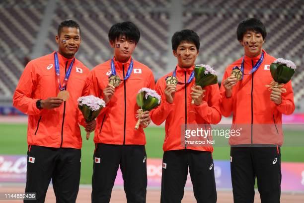 Julian Jrummi Walsh of Japan Kentaro Sato of Japan Rikuya Ito of Japan and Kota Wakabayashi of Japan celebrate during the medal ceremony for the...