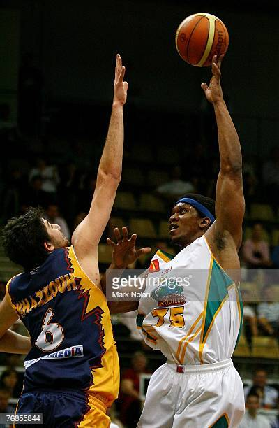 Julian Khazzouh of the Razorbacks defends as Rosell Ellis of Townsville shoots during the round one NBL match between the West Sydney Razorbacks and...