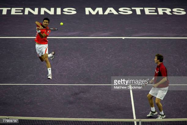 Julian Knowle of Austria returns a shot to Leander Paes of India and Martin Damm of the Czech Republic while playing with Simon Aspelin of Sweden in...