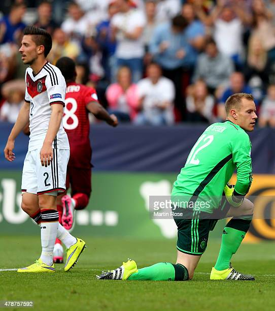 Julian Kob and goalkeeper Marc Andre ter Stegen of Germany look dejected during the UEFA European Under21 semi final match Between Portugal and...