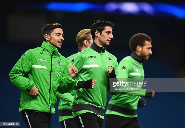Julian Korb and Lars Stindl jog during a VfL Borussia Moenchengladbach training session prior to the UEFA Champions League match against Manchester...