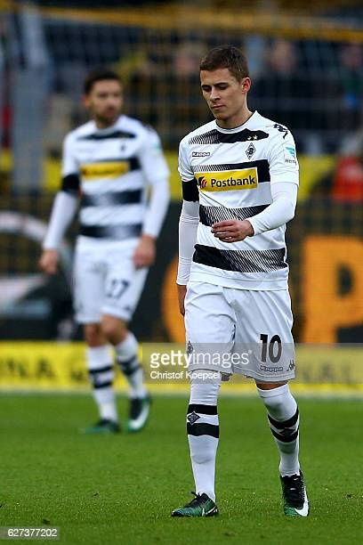 Julian Korb and Thorgan Hazard of Moenchengladbach look dejected after the third goal of Dormtund during the Bundesliga match between Borussia...