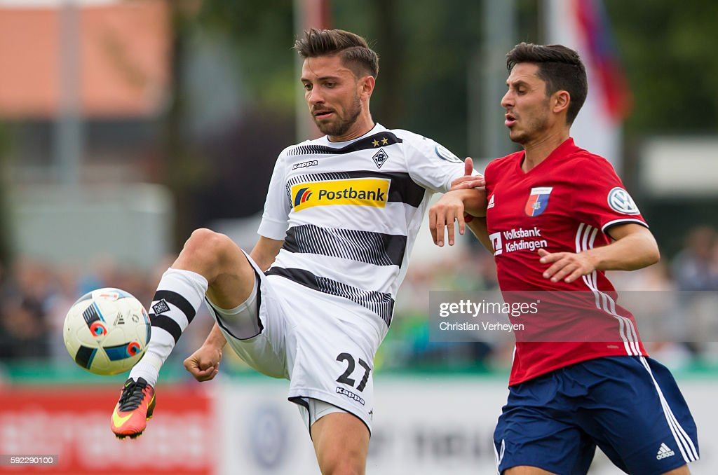 Julian Korb of Borussia Moenchengladbach and Oliver Ioannou of SV Drochtersen/Assel battle for the ball during the DFB Cup match between SV Drochtersen/Assel and Borussia Moenchengladbach at Kehdinger Stadion on August 20, 2016 in Drochtersen, Germany.