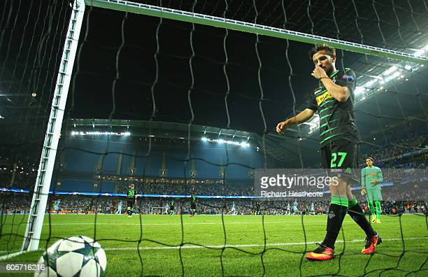 Julian Korb of Borussia Moenchengladbach picks the ball out from the back of the net during the UEFA Champions League match between Manchester City...