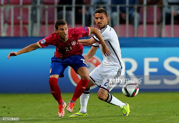 Julian Korb of Germany and Slavoljub Srnic of Serbia battle for the ball during the UEFA European Under21 Group A match between Germany and Serbia at...