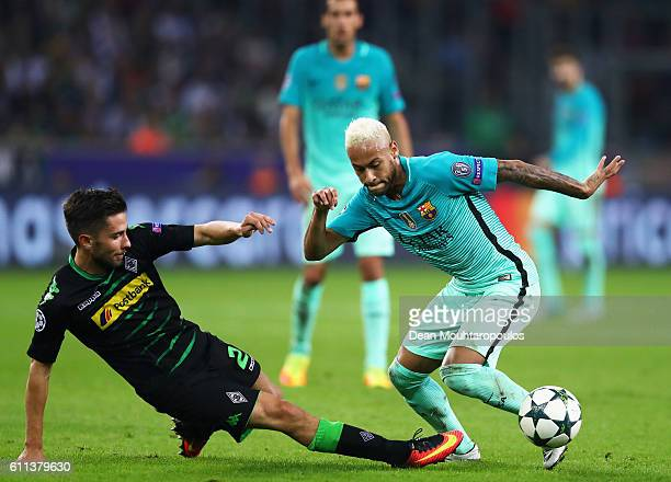 Julian Korb of Gladbach tackles Neymar of Barcelona during the UEFA Champions League group C match between VfL Borussia Moenchengladbach and FC...