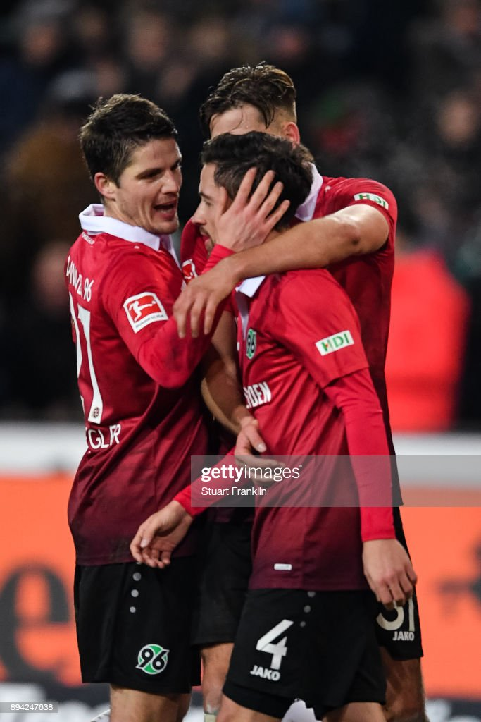 Julian Korb #4 of Hannover 96 celebrates with his team-mates after scoring a goal to make it 4-4 during the Bundesliga match between Hannover 96 and Bayer 04 Leverkusen at HDI-Arena on December 17, 2017 in Hanover, Germany.