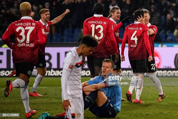 Julian Korb of Hannover 96 celebrates with his teammates after scoring a goal to make it 44 during the Bundesliga match between Hannover 96 and Bayer...