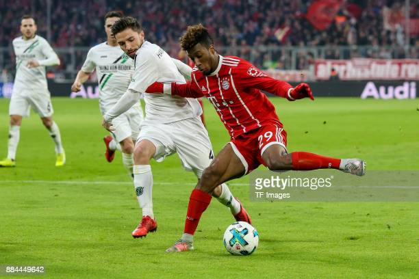Julian Korb of Hannover and Kingsley Coman of Bayern Muenchen battle for the ball during the Bundesliga match between FC Bayern Muenchen and Hannover...