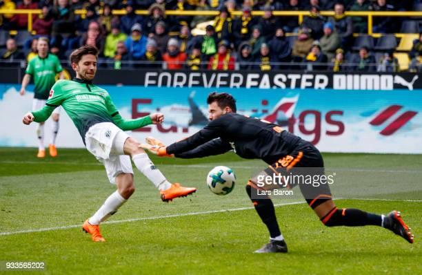 Julian Korb of Hannover scores an offside goal against Roman Buerki of Dortmund during the Bundesliga match between Borussia Dortmund and Hannover 96...