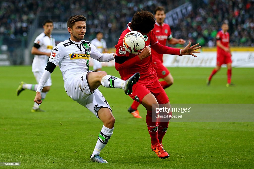 Julian Korb of Moenchengladbach challenges Miiko Albornoz of Hannover during the Bundesliga match between Borussia Moenchengladbach and Hannover 96 at Borussia-Park on November 21, 2015 in Moenchengladbach, Germany.