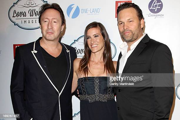 Julian Lennon and Lucie Laurier attends Lova World Images party during the 66th Annual Cannes Film Festival at Baoli Beach on May 22 2013 in Cannes...
