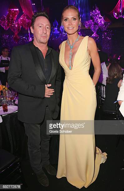 Julian Lennon and model Heidi Klum attends the amfAR's 23rd Cinema Against AIDS Gala at Hotel du CapEdenRoc on May 19 2016 in Cap d'Antibes France