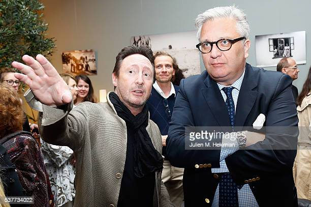 Julian Lennon is pictured with Prince Laurent of Belgium for his photo exhibition during the PHOTO HOUSE opening on June 2 2016 in Brussels Belgium