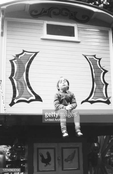 Julian Lennon son of John Lennon sitting on a covered wagon Germany circa 1966