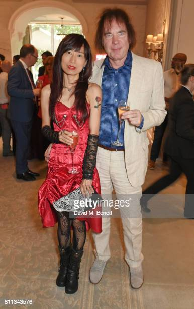 Julian Lloyd Webber and Jiaxin Cheng attend The South Bank Sky Arts Awards drinks reception at The Savoy Hotel on July 9 2017 in London England
