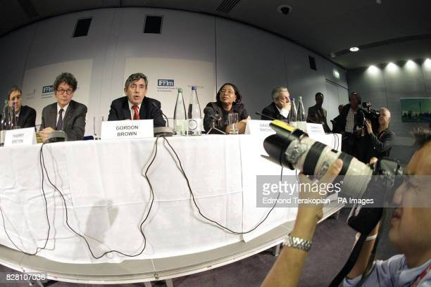 Julian LobLevy Thierry Breton Gordon Brown Graca Machel and Domenico Siniscalco as Chancellor of the Exchequer Gordon Brown chairs a press conference...