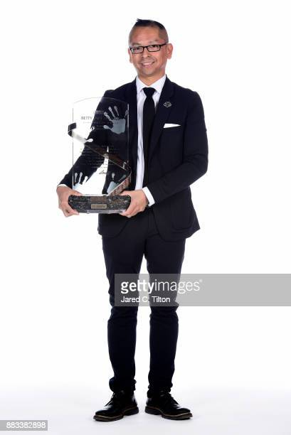 Julian Maha poses for a photo with the Betty Jane France Humanitarian Award during the Monster Energy NASCAR Cup Series awards at Wynn Las Vegas on...