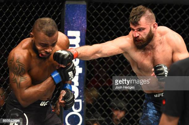 Julian Marquez punches Darren Stewart of England in their middleweight bout during the UFC Fight Night event at Bell MTS Place on December 16 2017 in...
