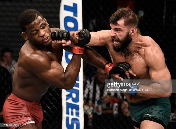 Julian Marquez punches Phillip Hawes in their middleweight bout during Dana White's Tuesday Night Contender Series at the TUF Gym on August 1 2017 in...
