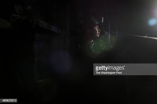 Julian Martinez stands by as a mining utility vehicle drives into place inside an emerald mind owned by Minería Texas Colombia a USA emerald mining...