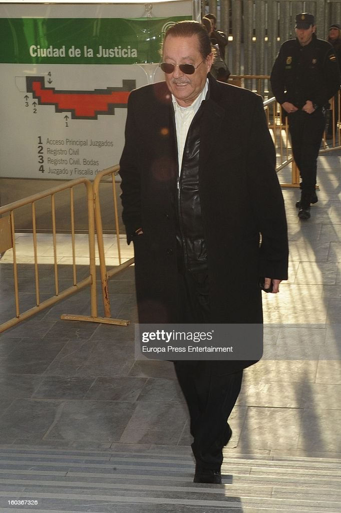 Julian Munoz arrives at Malaga court in the last day for the ongoing trial for alleged money-laundering and embezzlement on January 29, 2013 in Malaga, Spain. The 2006 scandal has put nearly 100 people on trial for alleged involvement in bribes to city officials by property developers for planning permissions.