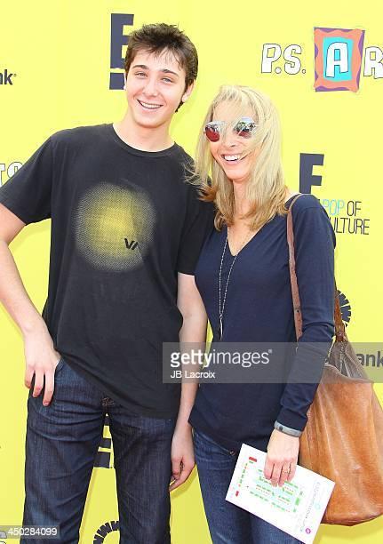 Julian Murray Stern and Lisa Kudrow attend the PS Arts Express Yourself 2013 at Barker Hangar on November 17 2013 in Santa Monica California