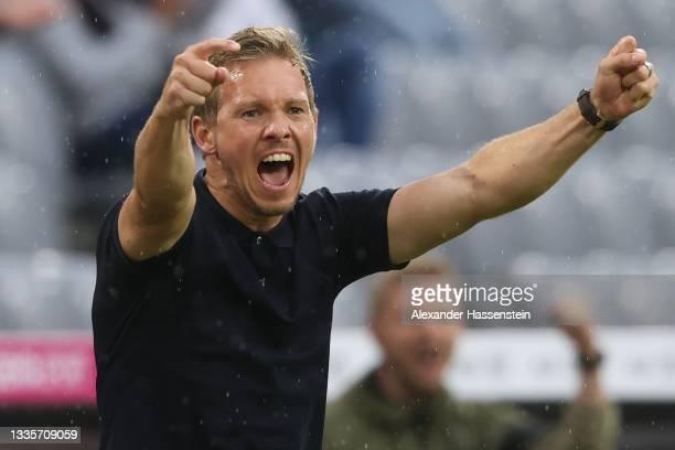 Julian Nagelsmann, Head Coach of FC Bayern Muenchen celebrates their side's third goal scored by Serge Gnabry of FC Bayern Muenchen during the...