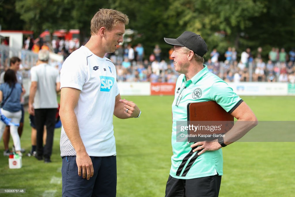 Julian Nagelsmann head coach of Hoffenheim talks to Steve McClaren head coach of Queens Park Rangers prior the pre-saeson friendly match between Queens Park Rangers and TSG 1899 Hoffenheim on July 21, 2018 in Eppingen, Germany.