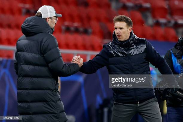 Julian Nagelsmann, Head Coach of RB Leipzig and Jurgen Klopp, Manager of Liverpool interact after the UEFA Champions League Round of 16 match between...