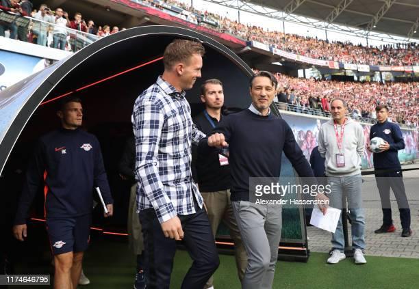 Julian Nagelsmann, Head Coach of RB Leipzig and Niko Kovac, Head Coach of FC Bayern Munich greet each other prior to the Bundesliga match between RB...