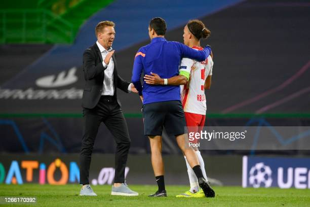 Julian Nagelsmann, Head Coach of RB Leipzig and Yussuf Poulsen of RB Leipzig celebrate following their team's victory in the UEFA Champions League...