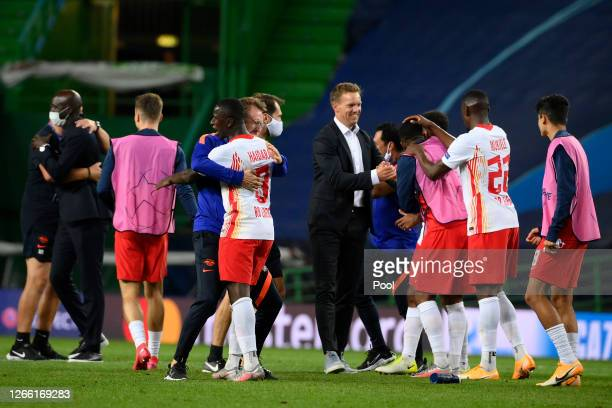 Julian Nagelsmann, Head Coach of RB Leipzig congratulates his players following their victory in the UEFA Champions League Quarter Final match...