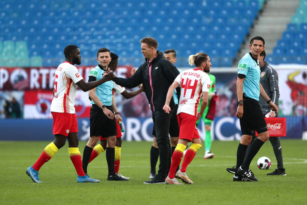 Julian Nagelsmann, Head Coach of RB Leipzig interacts with Dayot Upamecano of RB Leipzig after the Bundesliga match between RB Leipzig and VfB...