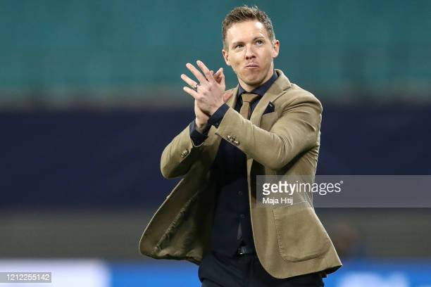 Julian Nagelsmann head coach of RB Leipzig shows appreciation to the fans after the UEFA Champions League round of 16 second leg match between RB...
