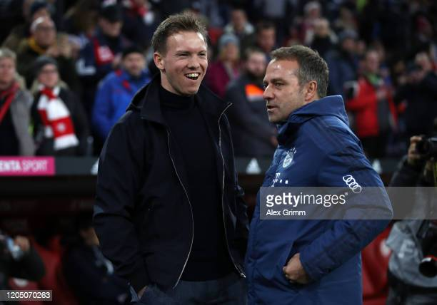 Julian Nagelsmann Head Coach of RB Leipzig speaks to HansDieter Flick Head Coach of Bayern Munich prior to the Bundesliga match between FC Bayern...