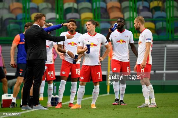 Julian Nagelsmann, Head Coach of RB Leipzig speaks with Christopher Nkunku, Marcel Sabitzer, Dayot Upamecano and Konrad Laimer of RB Leipzig during...