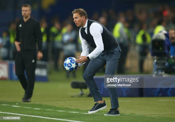 Julian Nagelsmann manager of 1899 Hoffenheim catches the match ball during the Group F match of the UEFA Champions League between FC Shakhtar Donetsk...