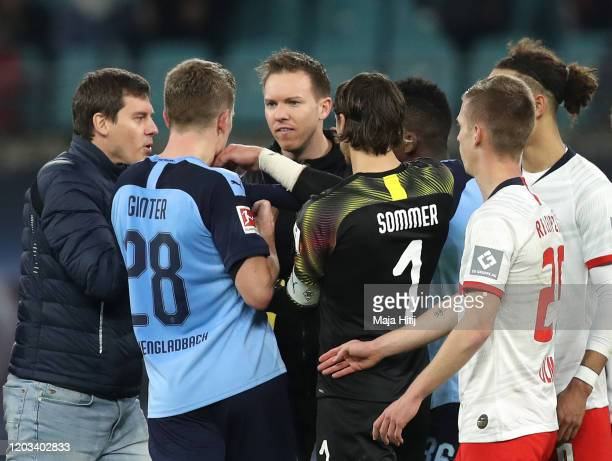 Julian Nagelsmann Manager of RB Leipzig and his players clash with players of Borussia Monchengladbach during the Bundesliga match between RB Leipzig...