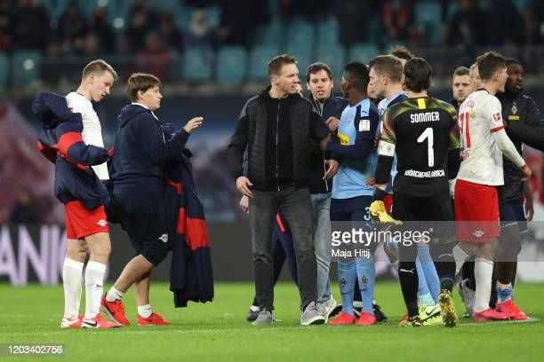 Julian Nagelsmann Manager of RB Leipzig and his players talk with players of Borussia Monchengladbach following the Bundesliga match between RB...