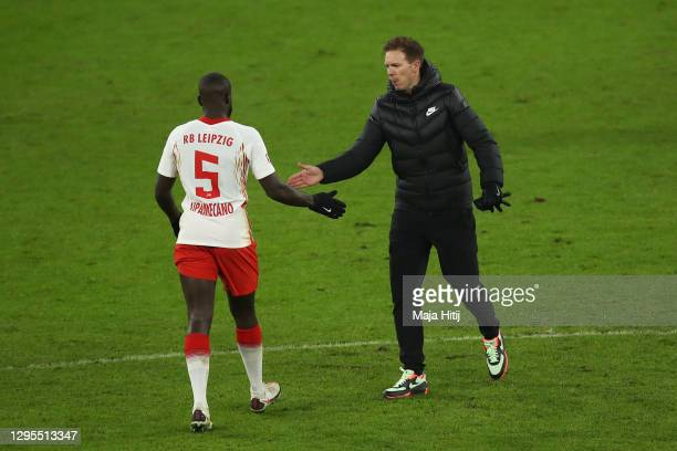 Julian Nagelsmann, Manager of RB Leipzig interacts with Dayot Upamecano of RB Leipzig after the Bundesliga match between RB Leipzig and Borussia...