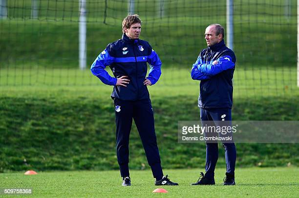 Julian Nagelsmann new head coach of TSG 1899 Hoffenheim exchanges words with assistant coach Alfred Schreuder during a training session on February...