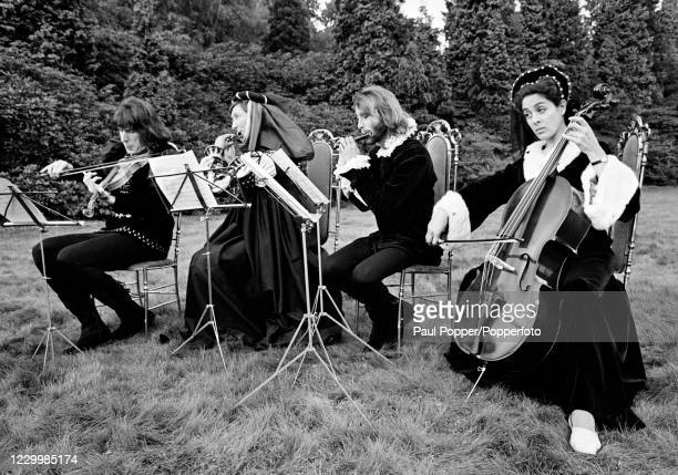 """Julian Orchard, Pat Coombs, Maurice Gibb and Eleanor Bron during the filming of """"Cucumber Castle"""", a comedy film written and produced by The Bee Gees..."""