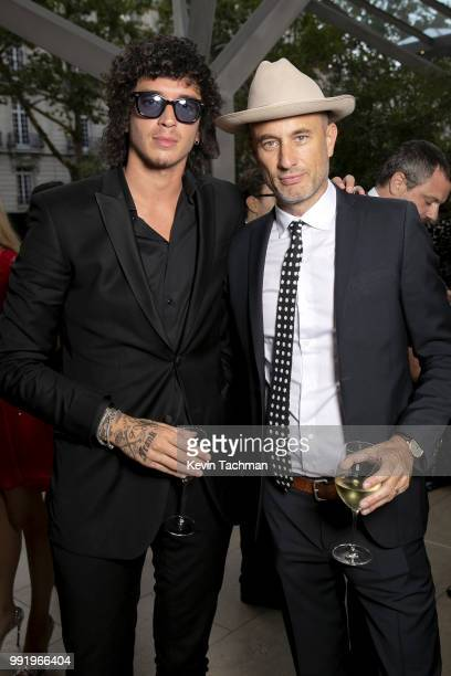 Julian Perretta and Andy Boose attend the amfAR Paris Dinner at The Peninsula Hotel on July 4 2018 in Paris France