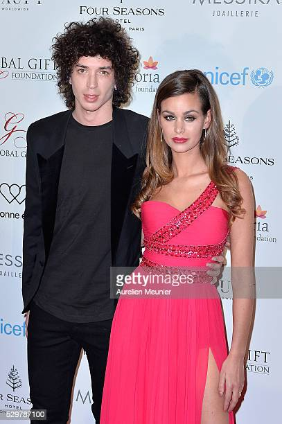 Julian Perretta and Elisa Bachir Bey attend the Global Gift Gala photocall at Four Seasons Hotel George V on May 9 2016 in Paris France