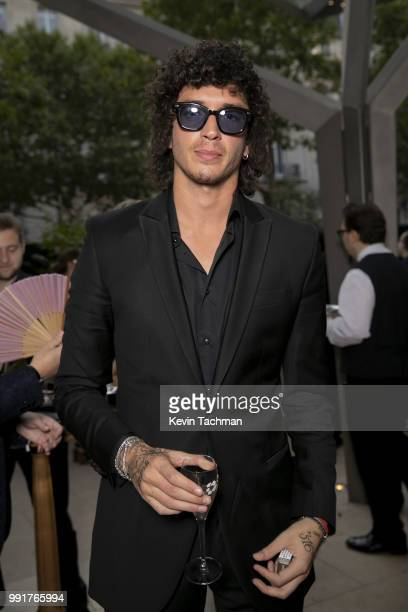 Julian Perretta attends the amfAR Paris Dinner at The Peninsula Hotel on July 4 2018 in Paris France