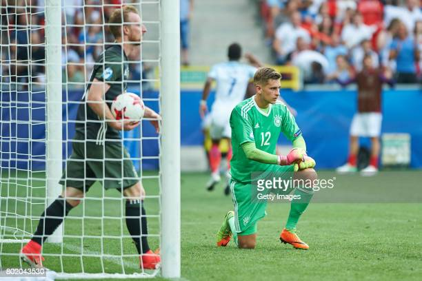 Julian Pollersbeck and Maximilian Arnold of Germany after the goal for England during the UEFA European Under21 Championship Semi Final match between...