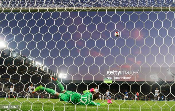 Julian Pollersbeck of Germany makes a save during the UEFA U21 championship match between Italy and Germany at Krakow Stadium on June 24 2017 in...
