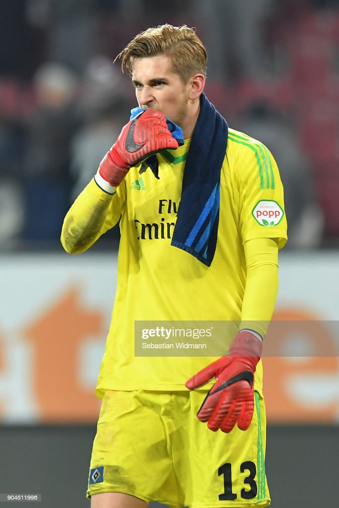 Julian Pollersbeck of Hamburg looks dejected after the Bundesliga match between FC Augsburg and Hamburger SV at WWK-Arena on January 13, 2018 in Augsburg, Germany.